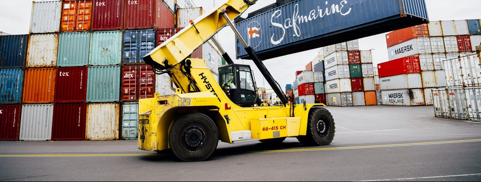 Forklift moving containers